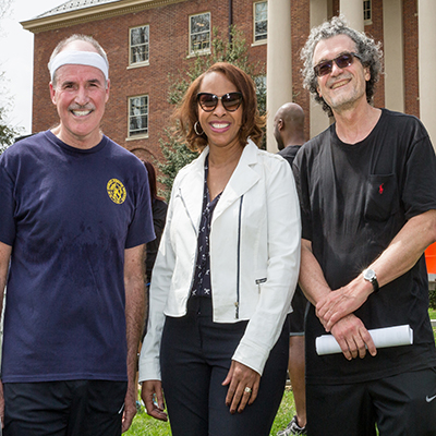 Dr. Eliseo J. Pérez-Stable, NIMHD Director (R), Rear Admiral Peter Kilmarx, Assistant Surgeon General and Deputy Director of the NIH John E. Fogarty Center (L), and Dr. Regina James, NIMHD Director of Clinical & Health Sciences Research (C)
