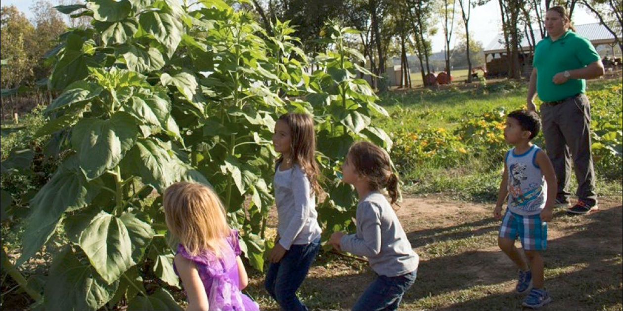 Osage children at a farm